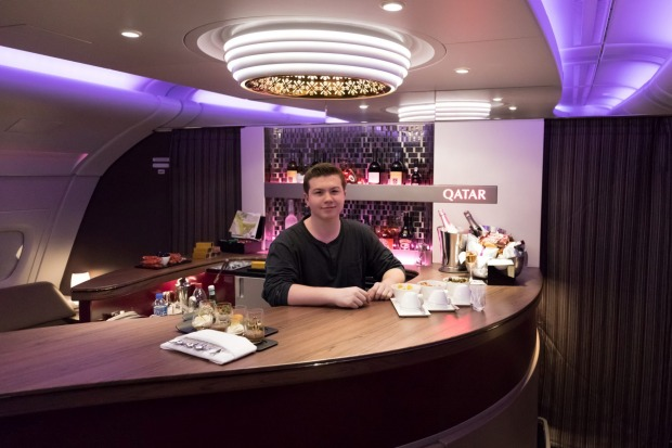 Sixteen-year-old travel blogger Zac George, pictured here at the bar on Qatar, became the youngest person ever to buy ...