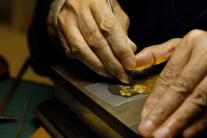 Working gold leaf for enamel at the Kyoto Museum of Traditional Crafts.