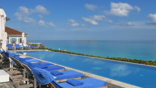 At the new beachside infinity pool, butlers offer bunches of frozen grapes, cool towels and lemonade.
