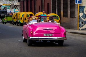 A vintage car passes Floridita restaurant in Old Havana.
