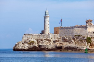 The Cuban flag fluttering on the Morro Castle, which guards the entrance to Havana Bay, alerted Ernest Hemingway to the ...