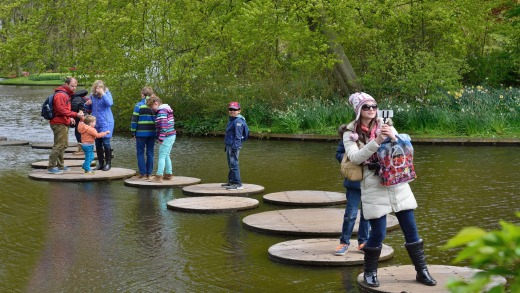 Negotiating the lily pad walkway over a pond at Keukenhof Gardens.