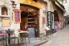 Narrow lane with local restaurants and souvenir shops in the old centre of San Marino capital on Monte Titano.