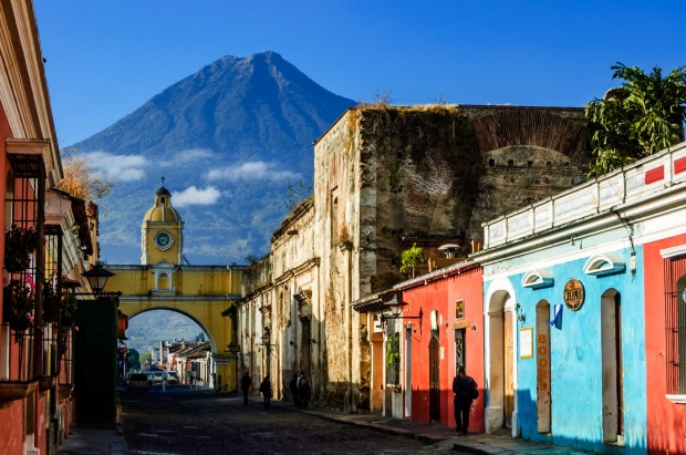 Locals walk to work along Antigua's famous cobblestone streets.