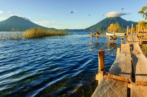 Early morning light on Toliman volcano, Guatemala. WHY GO With ancient Mayan cities, charming colonial towns and ...