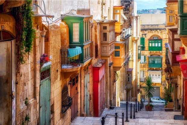 Streets of Valletta, the capital of Malta. WHY GO? Thanks to its colourful history, with conquerors including the ...