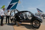Visitors looks at the flying car Pegasus 1, built by French entrepreneur Jerome Dauffy at Paris Air Show, in Le Bourget.