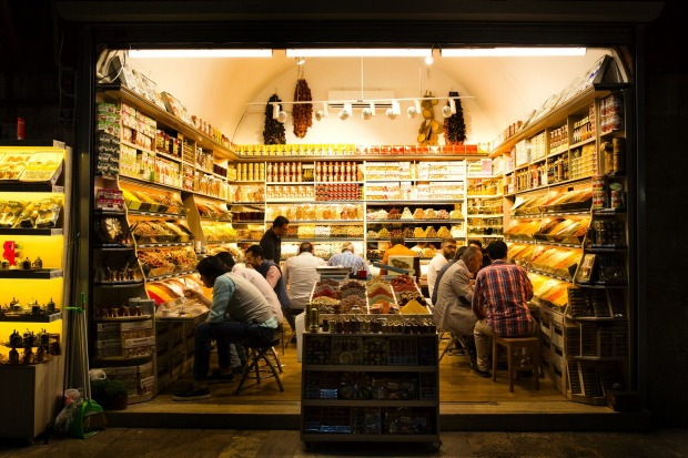 During the Islamic holy month of Ramadan, the stores don't close in Turkey's Grand Bazaar, so the staff members enjoy ...