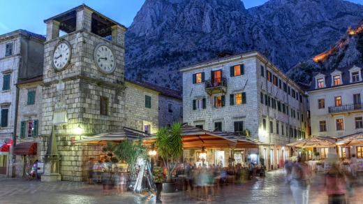 The medieval town of Kotor, Montenegro, at twilight, featuring the Square of Arms and the clock tower near the Maritime ...