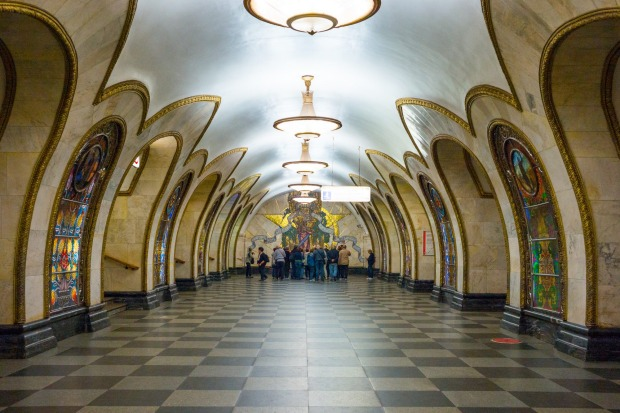 Visitors looking at the artworks in a Moscow subway station.