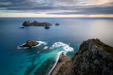 Dawn light creeping up on a cloudy sky over Lord Howe's Admiralty Islands. I woke up hours before sunrise and hiked to ...