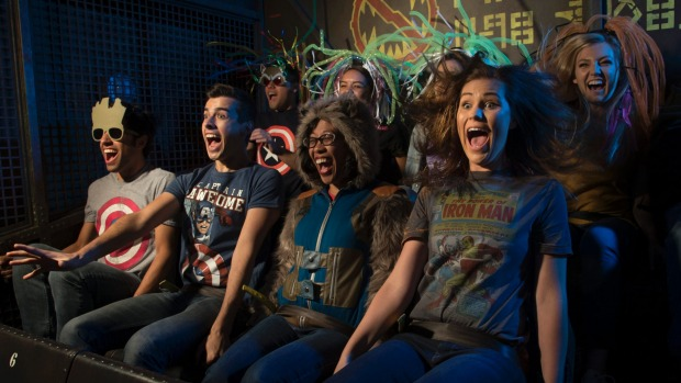 Guests freefall aboard a gantry lift at Guardians of the Galaxy Mission: BREAKOUT! as they join Rocket in an attempt to ...