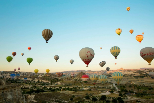 Sleeping under the stars and then waking up to this, an amazing hot-air balloon show over the fairy chimneys of ...