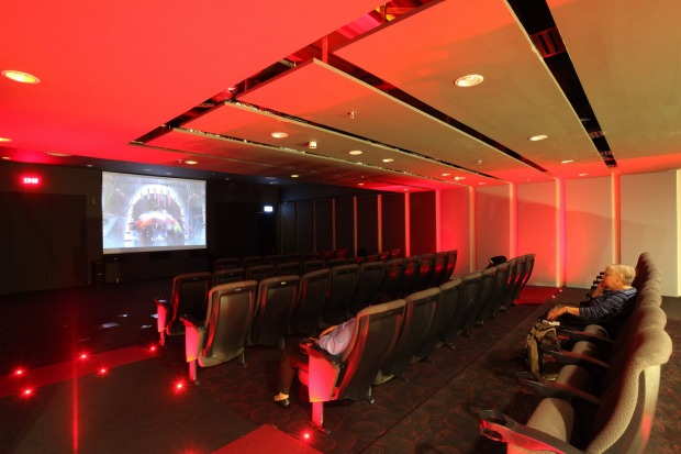 Movie theatre interior - latest blockbusters are free, 24 hours daily.