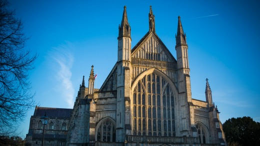 Sunlight catches the main facade of the cathedral in Wiltshire.