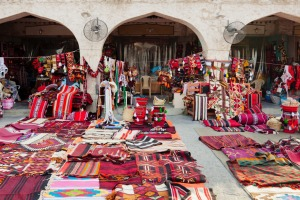 Textile shops along the street in the Souq Waqif.