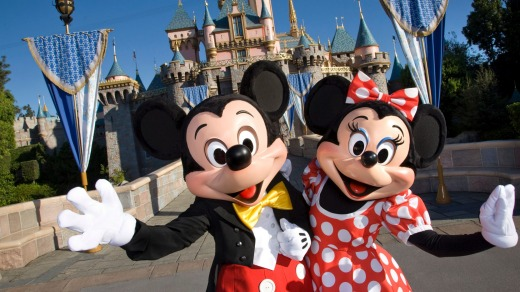 Mickey Mouse and Minnie Mouse welcome visitors to  Disneyland in California.