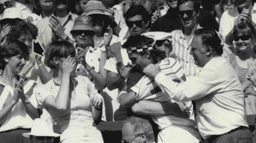 Pat Cash hugs his father after victory at Wimbledon in 1987.