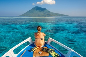 There's far more to Asia than just Bali: Sailing around volcano Manado Tua. North Sulawesi, Indonesia.