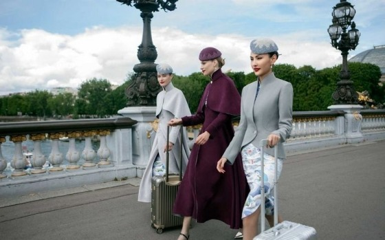 In-flight couture: Hainan Airlines' debuted its new uniform in Paris.