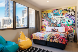 "Hilton's ""Graffiti loft"" features original artwork from local street artists 90 Degrees."