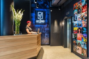 Front desk staff at the Jazz Corner Hotel, in Melbourne, wear red berets.