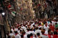 People pack the street ahead of the running of the bulls at the San Fermin Festival, in Pamplona, northern Spain.