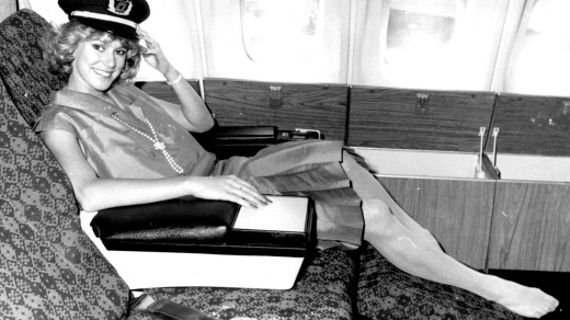 Miss Australia Tracey Pearson relaxes in Qantas business class in 1985.