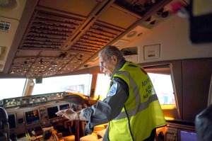 Mechanic Azriel Blackman, 91, at work aboard a jet in an American Airlines hangar at Kennedy International Airport in ...