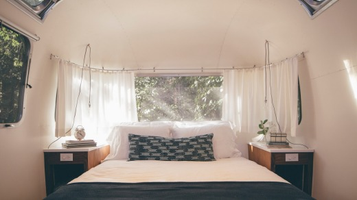 A bedroom inside an AirStream.