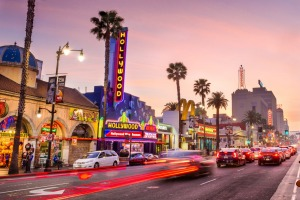 Hollywood Boulevard at dusk. The theatre district serves as a famous tourist attraction.
