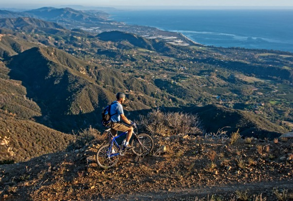 Mountain biking the Romero Road Trail overlooking the Pacific Ocean and the city of Santa Barbara in the Santa Ynez ...