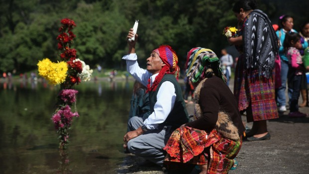 Indigenous people pray at the shore of the Chicabal lagoon during the Prayer of the Rain in Quetzaltenango.