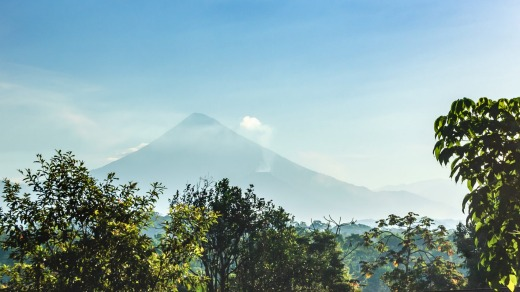 Chicabal volcano rises out of the forest.
