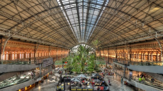 People sit in a cafe by the tropical garden at Madrid's Atocha station.