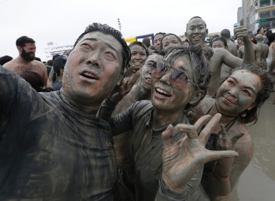 People take a selfie during the Boryeong Mud Festival at Daecheon Beach in Boryeong, South Korea. The 20th annual mud ...