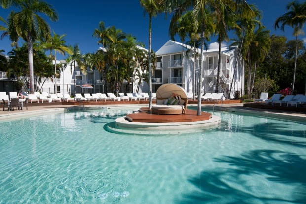 There are plenty of deck chairs around the lagoon-style pool that has a shallow end for littlies and a swim-up bar for ...