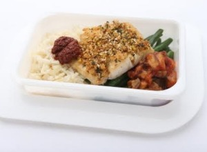 A tasty economy-class dish: Spiced, crusted kingfish with eggplant and capsicum relish, served with green beans and rice.