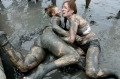 BORYEONG, SOUTH KOREA - JULY 22: Festival-goers enjoy the mud during the annual Boryeong Mud Festival at Daecheon Beach ...