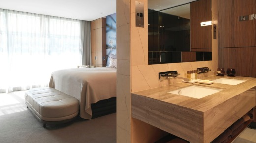 Like so many modern hotels, the bathroom is not a 'room' in itself, but rather is integrated into the overall space.