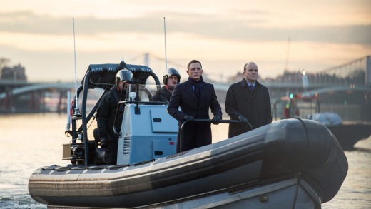 Bond (Daniel Craig) and Tanner (Rory Kinnear) passing the CNS building aboard the rib on the River Thames in London in  ...