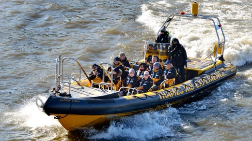 Tourists speed along the Thames with music blasting.