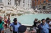 Volunteers control the flow of visitors to the Trevi Fountain in Rome this week.