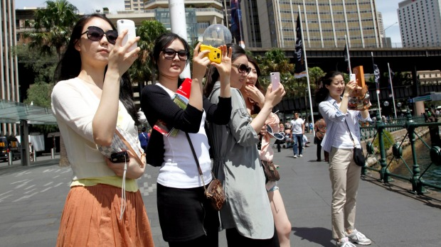 Chinese tourists in Sydney. Chinese tourists now spend $300 billion overseas each year.