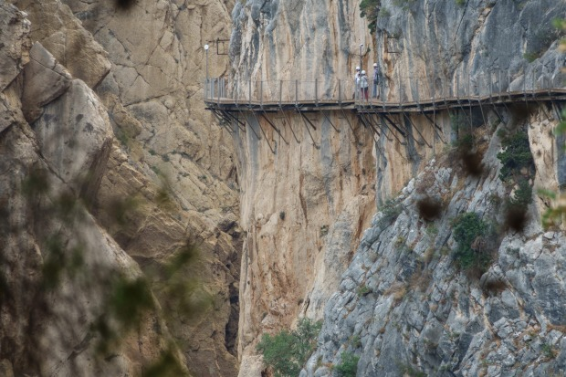 """CAMINITO DEL REY, SPAIN- Pinned to the sheer walls of El Chorro Gorge in Malaga, the """"Little Path of the King"""" is not ..."""