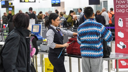 Airport security staff check bags at Melbourne Airport this week.