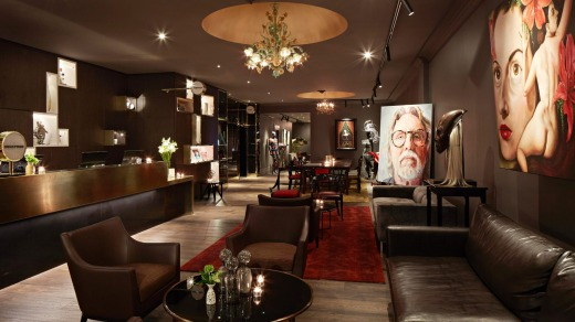 The art-filled lobby of the QT Museum Hotel in Wellington.