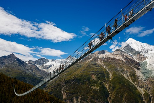 """People walk on the """"Europabruecke"""",  the world's longest pedestrian suspension bridge with a length of 494m, after its ..."""