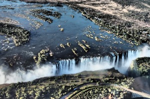 Taken whilst in our helicopter, flying over Victoria Falls. The mighty Zambezi rapidly plunges into the gorge below, ...