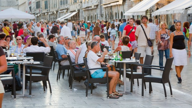 Tourists crowd the streets of Dubrovnik.